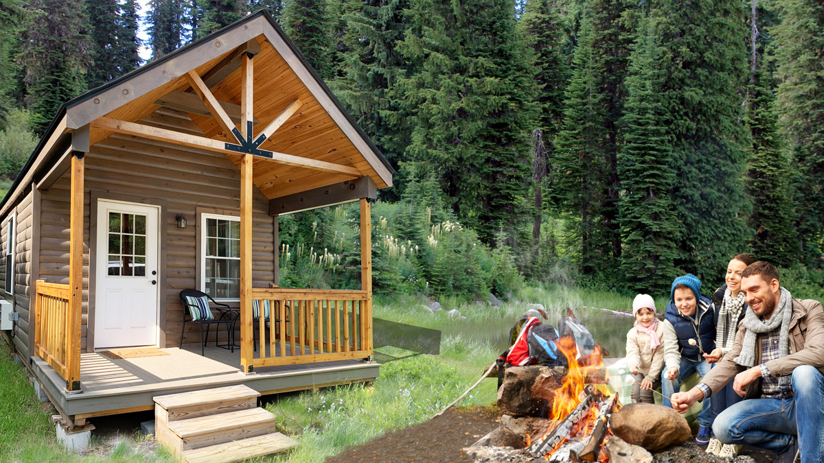 Prefab Log Cabin Home with family by the fire